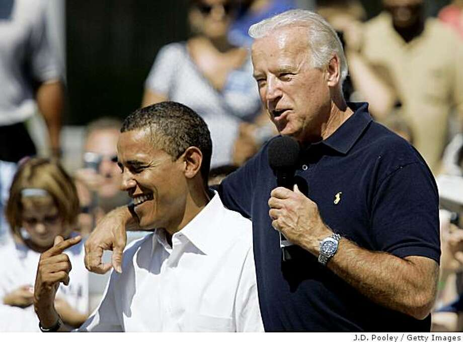 TOLEDO, OH - AUGUST 31: Democratic U.S. presidential nominee Sen. Barack Obama (D-IL) (L) jokes with his running mate Democratic U.S. vice-presidential nominee Sen. Joe Biden (D-DE) as they campaign together at the Toledo-Lucas County Public Library August 31, 2008 in Toledo, Ohio. Obama and Biden are campaigning throughout Ohio and Michigan while the Republicans elsewhere prepare for their convention in Saint Paul following last week's Democratic Convention. (Photo by J.D. Pooley/Getty Images) Photo: J.D. Pooley, Getty Images