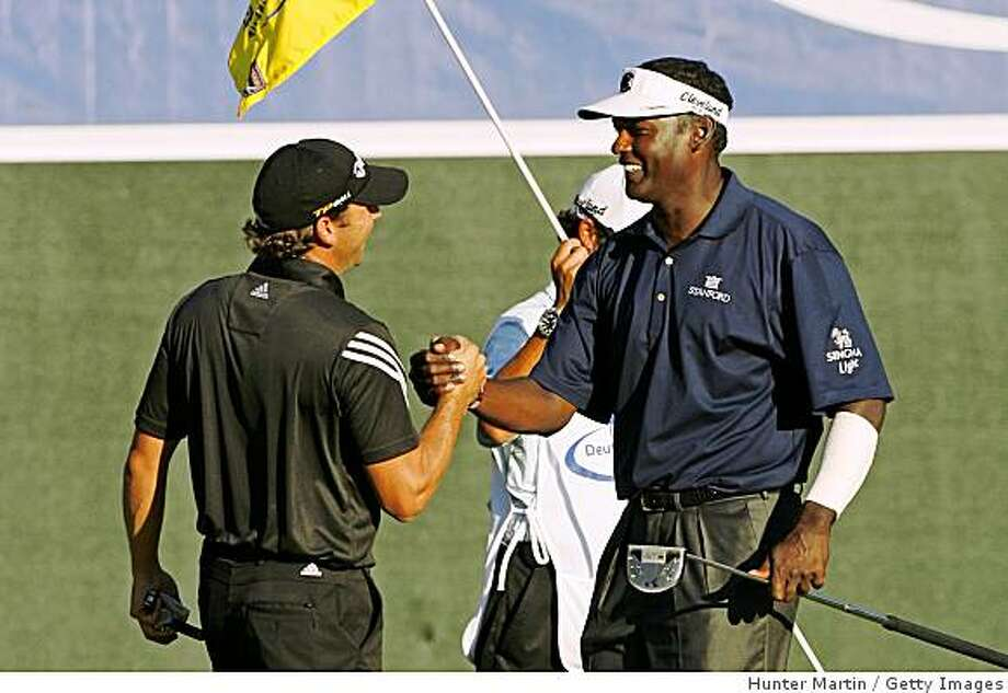 Sergio Garcia shakes hands with Vijay Singh on the 18th hole during the final round Deutsche Bank Championship at TPC Boston on September 1, 2008 in Norton, Massachusetts. Photo: Hunter Martin, Getty Images
