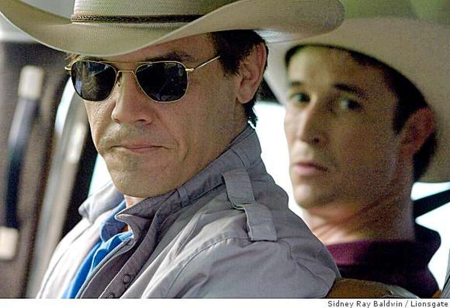 "Josh Brolin as George W. Bush and Noah Wyle as Don Evans in ""W.""  2008. Photo: Sidney Ray Baldwin, Lionsgate"
