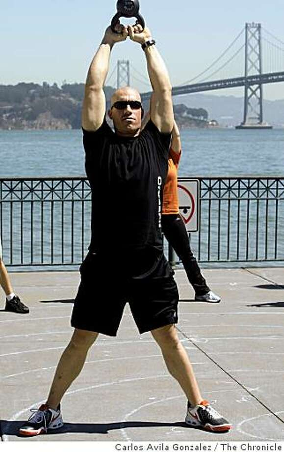 Chris LaLanne, grandnephew of Jack LaLanne, the 93-year-old fitness guru who was born in San Francisco, is giving his famous relative a run for his fitness money. LaLanne, with ripped body and shaved head, has just opened his own gym in San Francisco's South of Market. LaLanne the younger trained for years with LaLanne the elder, but has tweaked his mentor's approach to make it his own. Photo: Carlos Avila Gonzalez, The Chronicle