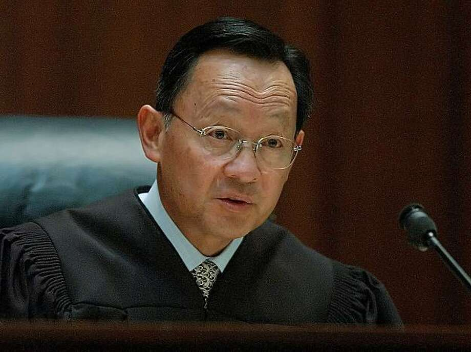 California Supreme Court Justice Ming Chin speaks in a San Francisco courtroom in this May 25, 2004, photo. Justice Chin, recovering from January 2006, skull surgery, will be sidelined from taking the bench during oral arguments for what will be the third month in a row when the justices begin holding public sessions in San Francisco  Tuesday, March 7, 2006. While the timing of the 63-year-old Chin's return to the public spotlight is uncertain, his absence from the bench is delaying cases and at times causing lower court judges to fill the vacuum. (AP Photo/Paul Sakuma) Photo: Paul Sakuma, AP