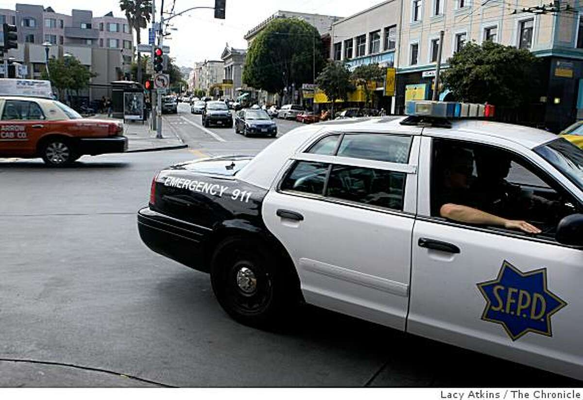 A police car crosses the intersection of 16th and Mission on Aug. 21, 2008, in San Francisco, Calif. 58 robberies have taken place at the intersection during 2007 and the first half of 2008.