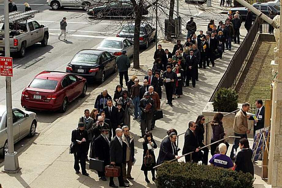 NEW YORK - MARCH 10:  Job seekers wait on line to attend a UJA-Federation of New York job fair on March 10, 2010 in the Brooklyn borough of New York City.  Hundreds of people attended the one day job fair which featured employers from a broad cross section of professions. In further news that the recession may be coming to an end, the American economy lost fewer jobs than expected last month the Labor Department reported. The economy lost 36,000 jobs in February, with the unemployment rate holding at 9.7percent. Photo: Spencer Platt, Getty Images