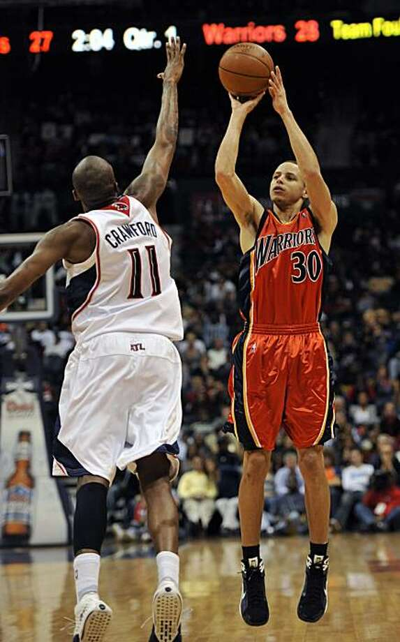 Golden State Warriors guard Stephen Curry (30) takes a shot against Atlanta Hawks guard Jamal Crawford (11)  during the first quarter of an NBA basketball game at Philips Arena, Friday, March 5, 2010, in Atlanta. Photo: Gregory Smith, AP