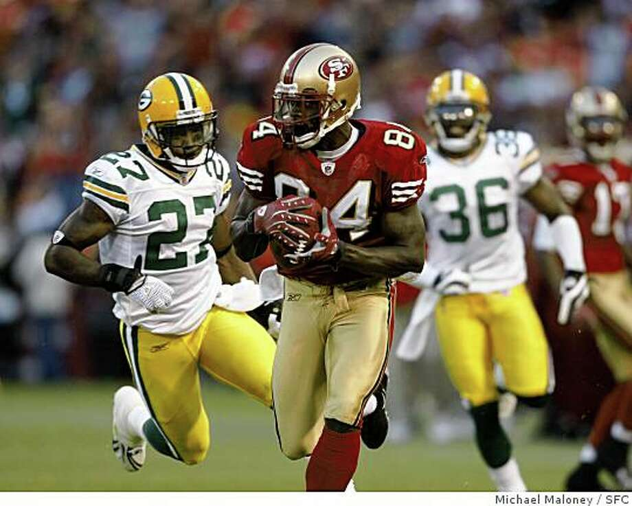 San Francisco 49ers Josh Morgan runs to the endzone on his 2nd quarter touchdown, pursued by Packers Will Blackmon, left and Nick Collins..The San Francisco 49ers host the Green Bay Packers in an NFL preseason game at Candlestick Park in San Francisco, Calif., on August 16, 2008. Photo: Michael Maloney, SFC