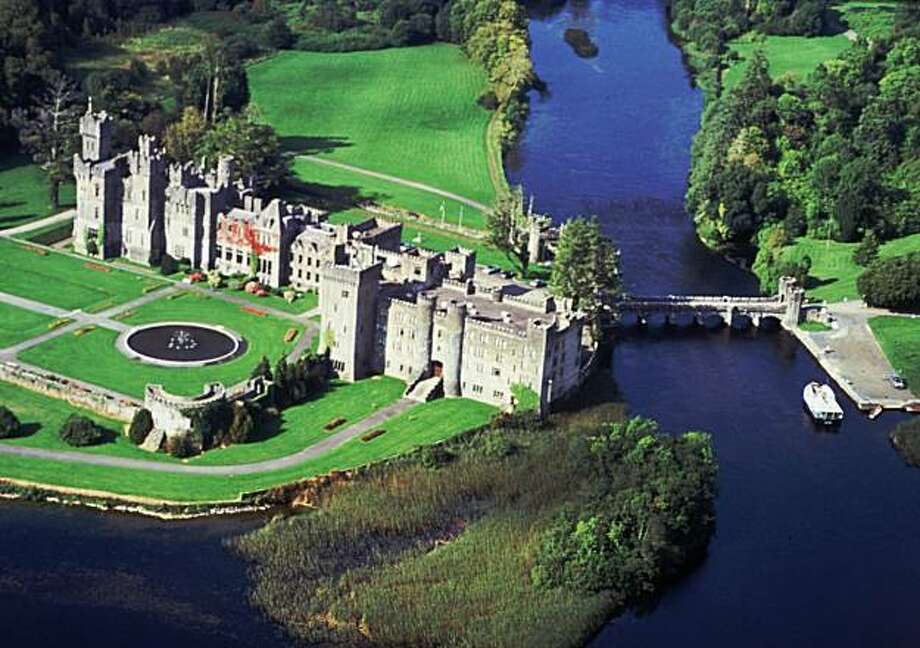 "This is an aerial view of Ashford Castle, the now five-star hotel outside Cong, Ireland, where many of the outdoor scenes from the film, ""The Quiet Man,"" were shot. When director John Ford and his moviecrew were staying there in 1951, however, the castle was more a drafty barn without heat, elevators or telephones.(AP Photo/Irish Tourist Board) Photo: Irish Tourist Board, AP"