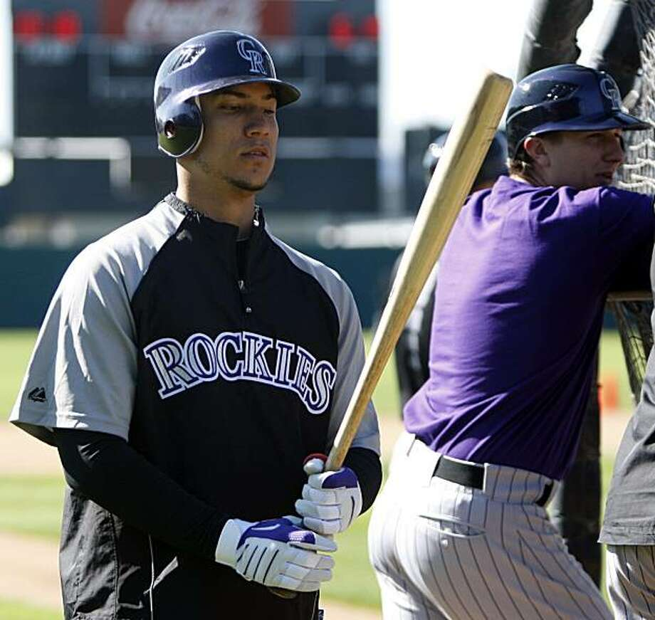 Colorado Rockies outfielder Carlos Gonzalez gets ready to step into the batting cage at the Rockies' spring training baseball facility in Tucson, Ariz., on Thursday, Feb. 25, 2010. Photo: Ed Andrieski, AP