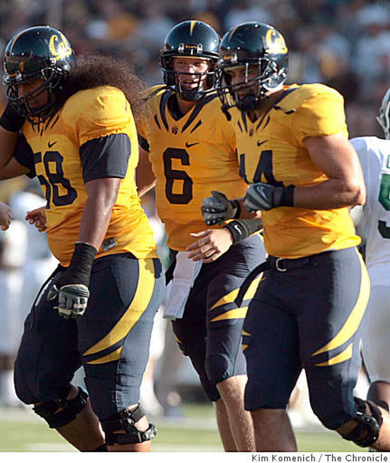 Cal quarterback Nate Longshore, center, leaves the field with Chet Teofilo , left, and Tad Smith as Cal plays Michigan State at Memorial Stadium in Berkeley Calif., on Saturday, Aug. 30, 2008. Photo: Kim Komenich, The Chronicle