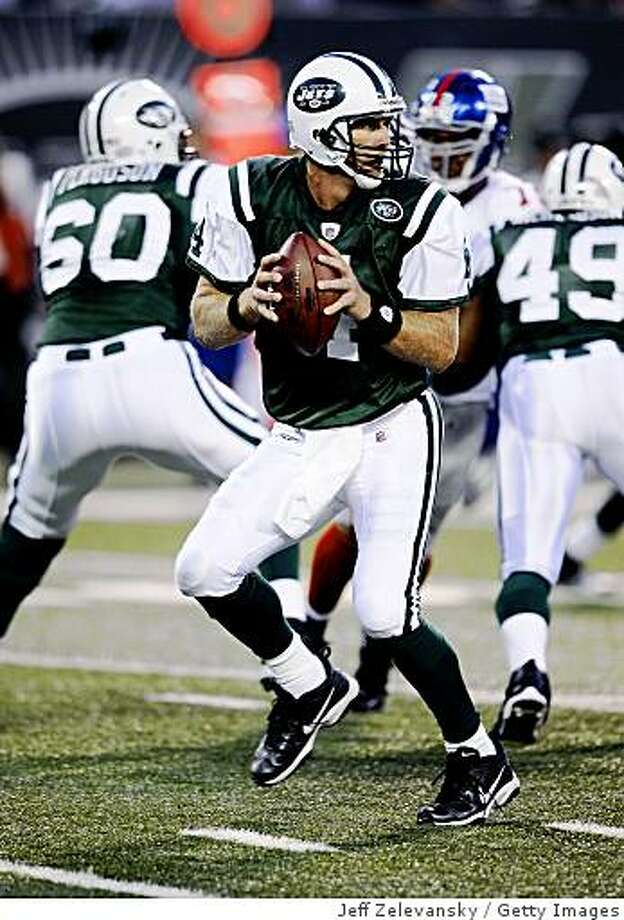 EAST RUTHERFORD, NJ - AUGUST 23:  Brett Favre #4 of the New York Jets looks to pass during a preseason NFL game against the New York Giants at Giants Stadium in the Meadowlands August 23, 2008 in East Rutherford, New Jersey.  (Photo by Jeff Zelevansky/Getty Images) Photo: Jeff Zelevansky, Getty Images