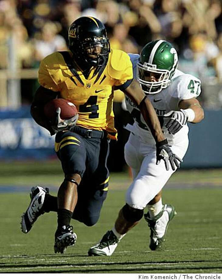 Cal's Jahvid Best runs in the second quarter against Michigan State defender Brandon Long as Cal plays Michigan State at Memorial Stadium in Berkeley Calif., on Saturday, Aug. 30, 2008. Photo: Kim Komenich, The Chronicle