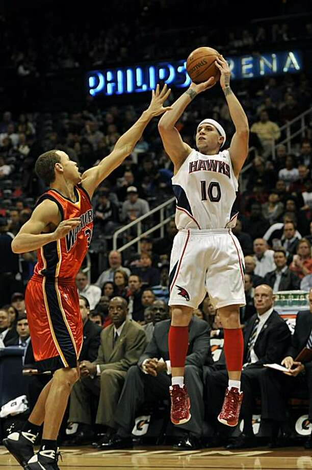 Atlanta Hawks guard Mike Bibby (10) takes a shot against Golden State Warriors guard Stephen Curry, left, during the first quarter of an NBA basketball game at Philips Arena, Friday, March 5, 2010, in Atlanta. Photo: Gregory Smith, AP