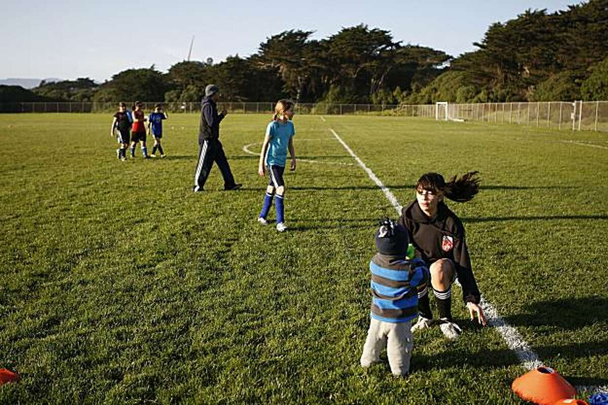 The North Beach Wild Parrots Soccer team getting ready for practice at the Golden Gate Park soccer field at Beach Chalet in San Francisco, Ca., on Wednesday, February 3, 2010. The team is comprised of 6 different SF middle schools and has been using this field for practice.