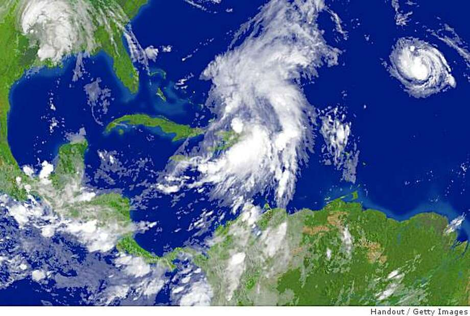 IN SPACE - SEPTEMBER 3:  In this satellite image provided by the National Oceanic and Atmospheric Administration (NOAA), storm systems (L-R) Gustav, Hanna and Ike are seen on September 3, 2008. (Photo by NOAA via Getty Images) Photo: Handout, Getty Images