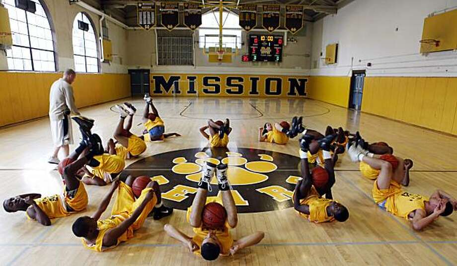 The Mission boys basketball team does some warm up exercises during practice on Monday, March 8, 2010, at Mission High in San Francisco, Calif.The Mission boys basketball team won the city championship over the weekend. Considering what the team's been through, it is an against-all-odds story of success in the oft-maligned world of S.F. public school athletics. Photo: Carlos Avila Gonzalez, The Chronicle