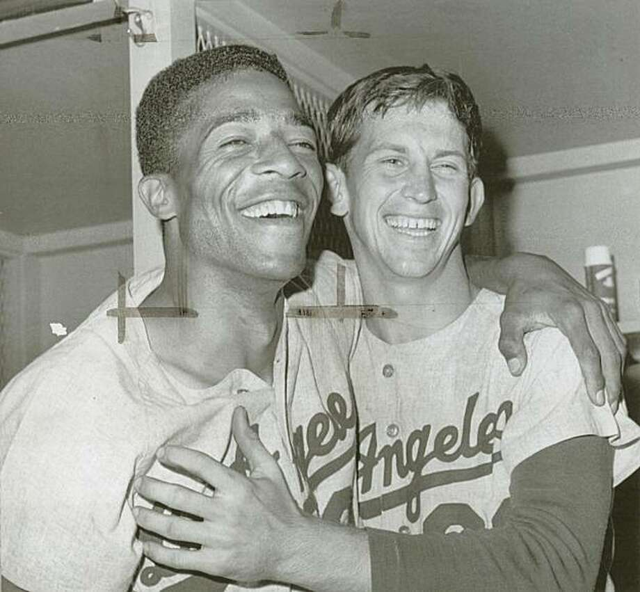 Jenkins Davis.jpg  Aug 28. 1966 - Willie Davis (left) and Don Sutton of the Los Angeles Dodgers after a 5-2 defeat of the Giants in San Francisco on Aug. 28, 1966. Photo: Upi 1966