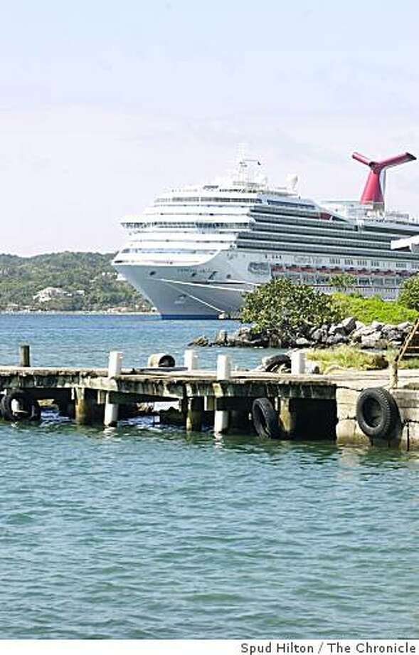 Carnival Cruise Line ship Carnival Valor, seen docked on Isla Roatan, Honduras. The ship is the first of Carnival's fleet to have its cabins reclassified based on location and convenience to popular ship features. Photo: Spud Hilton, The Chronicle