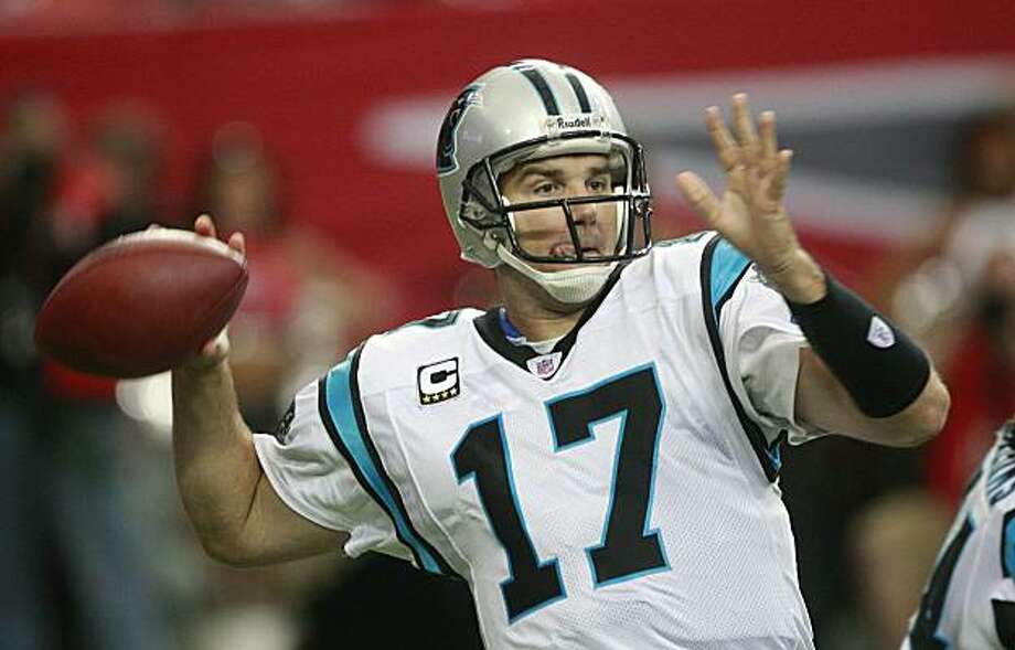 Carolina Panthers quarterback Jake Delhomme (17) looks for a receiver during their NFL football game against the Atlanta Falcons at the Georgia Dome in Atlanta, Sunday, Sept. 20, 2009. (AP Photo/Dave Martin) Photo: Dave Martin, AP