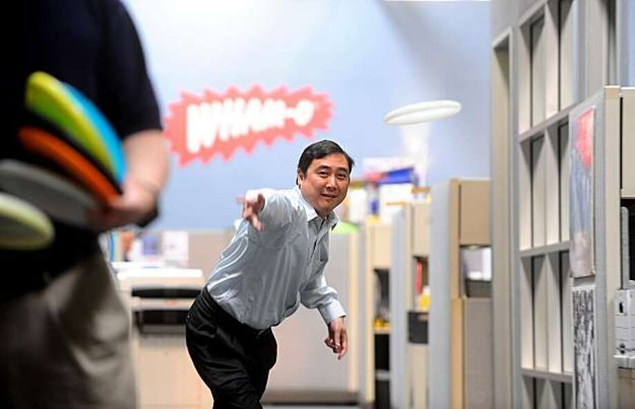 Blake Wong, CFO of Wham-O, tosses a Frisbee at his company's Emeryville, Calif., headquarters on Wednesday, Feb. 24, 2010.Blake Wong, CFO of Wham-O, tosses a Frisbee at his company's Emeryville, Calif., headquarters on Wednesday, Feb. 24, 2010. Photo: Noah Berger, Special To The Chronicle