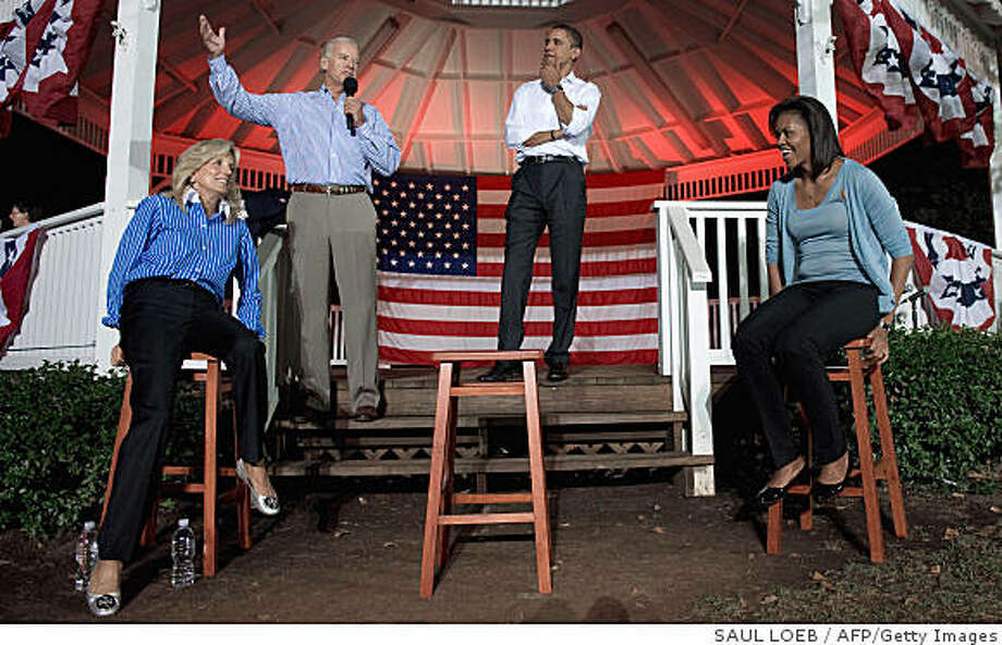 US Democratic presidential nominee Barack Obama (2nd R) and Obama's wife Michelle (R) listen as US Democratic vice presidential nominee Joe Biden (2nd L) addresses rally beside his wife Jill (L) during a campaign stop August 29, 2008 at Quay Park on Irving Square in Beaver, Pennsylvania. Fresh off his reception at the Democratic National Convention, Obama beat a path to the post-industrial landscape of Pennsylvania, pitching for votes from blue collar voters dubious of his promise of change.   AFP PHOTO / SAUL LOEB (Photo credit should read SAUL LOEB/AFP/Getty Images) Photo: SAUL LOEB, AFP/Getty Images