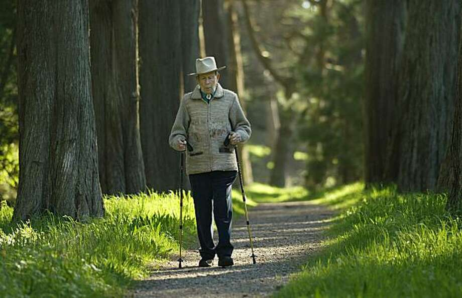 Dr. Edgar Wayburn who still tries to walk a mile and a half a day walks through a grove of Monterey Pines inside the Fort Scott area of the Presideo.    Dr. Edgar Wayburn,97, a former five-term president of the Sierra Club, has led decades-long campaigns to save not only Bay Area open space but more than 100 million acres of american wilderness and parklands.   event on 3/19/04 in Point Reyes Photo: Michael Macor, The Chronicle
