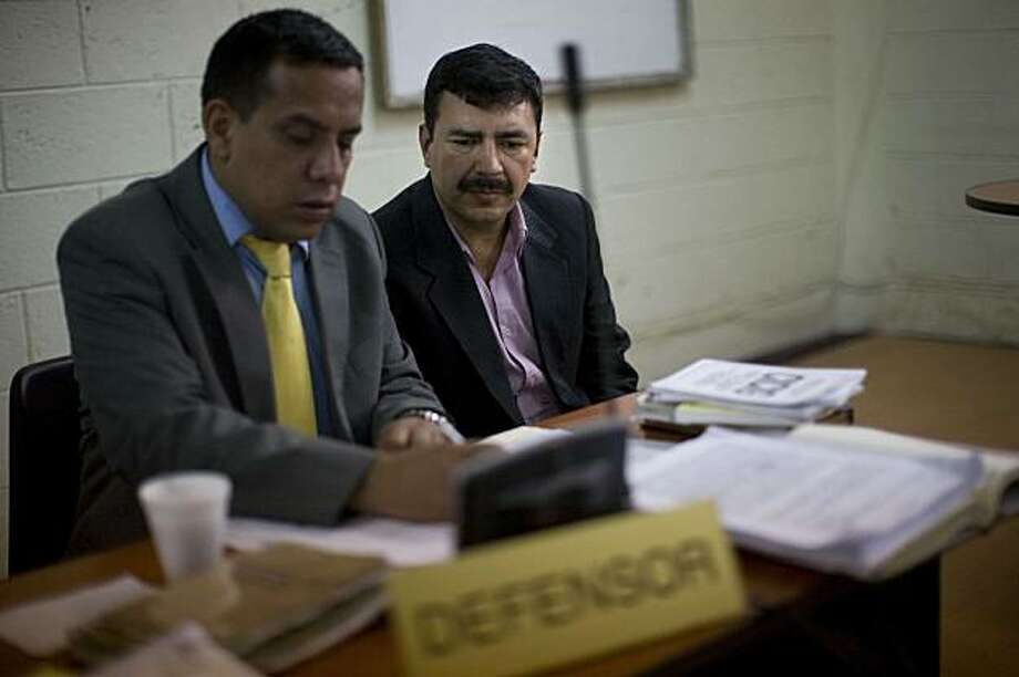 Former National Police Chief Baltazar Gomez, right, who was arrested Tuesday, sits by his lawyer at his hearing in Amatitlan, Guatemala, Wednesday, March 3, 2010.  Gomez and the government's drug czar Nelly Bonilla were arrested Tuesday as the alleged leaders of a gang of police who stole more than 1,500 pounds of cocaine from traffickers. The arrests underscore how deeply the world's multibillion-dollar drug industry can corrupt small countries with weak institutions, a trend the Obama administration warned Wednesday threatens global security. Photo: Rodrigo Abd, AP