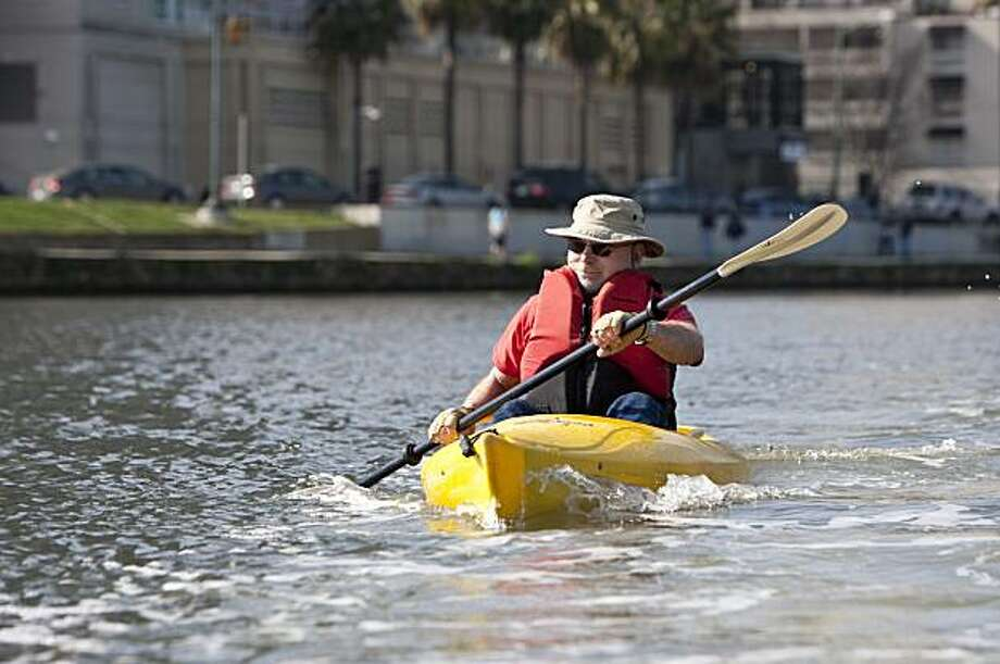 Tom Libby kayaks around Lake Merritt in Oakland, Calif., on Sunday, February 14, 2009. Photo: Laura Morton, Special To The Chronicle
