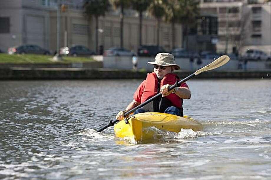 Tom Libby kayaks around Lake Merritt in Oakland, Calif., on Sunday, February 14, 2009. Photo: Laura Morton, Special To The Chronicle