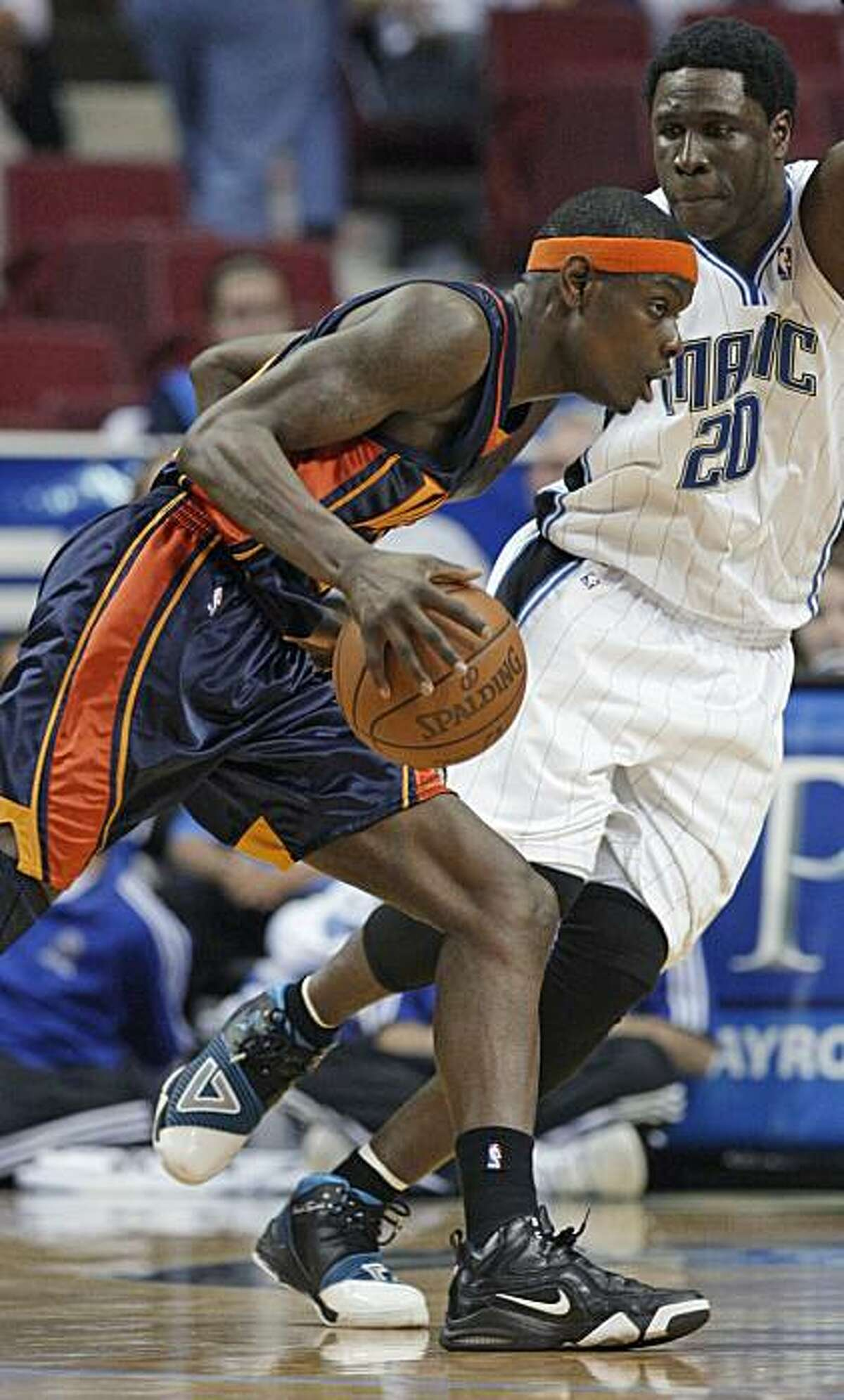 Golden State Warriors guard Anthony Morrow, left, drives around Orlando Magic forward Mickael Pietrus (20), of France, during the second half of an NBA basketball game in Orlando, Fla., Wednesday, March 3, 2010. Orlando won 117-90.
