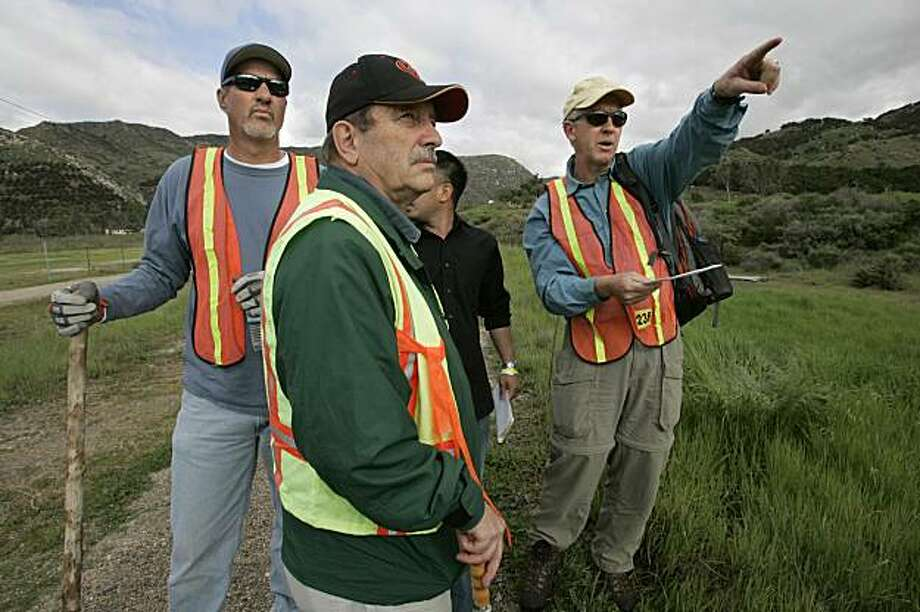 Part of a search group in Bandy Canyon, from left, Wayne Hickey,  Greg Post, De Le, partially hidden, and Larry Luke   decided how to proceed in their search for missing tennager Chelsea King Sunday Feb. 28, 2010 in Sandiego County, Calif. Photo: Peggy Peattie, AP