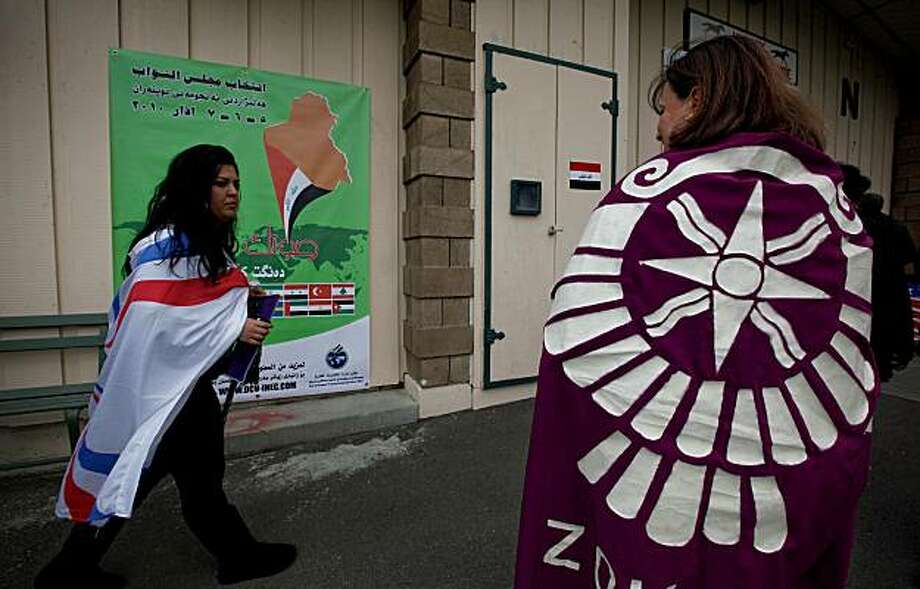 Tina Toma, (left) of Ceres and Vibronia Younan,  show their support for the Assyrian Democratic Movement as they arrive at the Iraqi polling center at the Alameda County Fairgrounds in Pleasanton, Calif. on Friday Mar. 5, 2010. The center is one of eight places across the country where Iraqis living in the United States can vote in their nation's elections. Photo: Michael Macor, The Chronicle