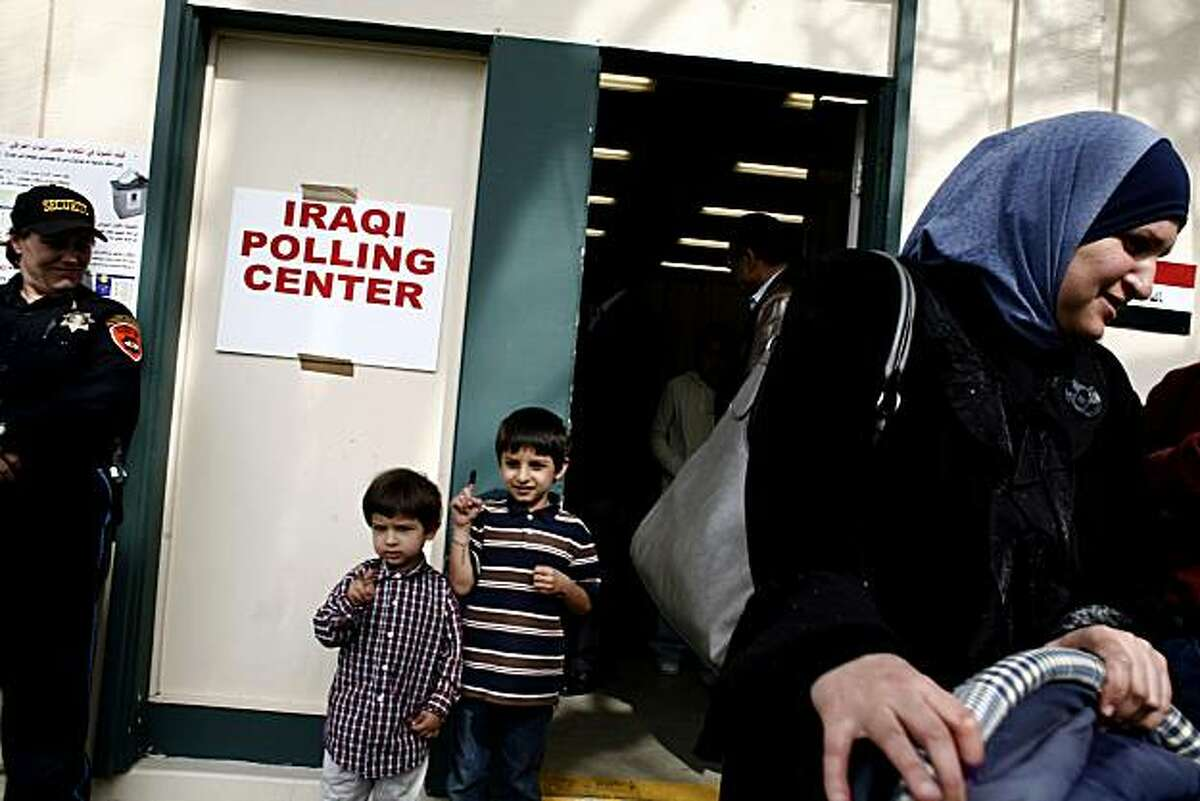 Ghosoon Aljewad from Santa Cruz leaves the polling center after voting for the Iraq elections at the Alameda County Fairgrounds in Pleasanton. For fun, poll workers dipped her children Husian Aljewad's and Moratha Aljewad's fingers into the electoral ink which is a security feature to prevent double voting in the Iraq Election. The site is one of eight places across the country where Iraqis living in the United States can vote in their nation's elections on Friday, Mar. 5, 2010 in Pleasanton, Calif.