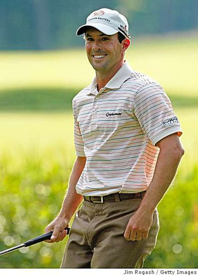 NORTON, MA - AUGUST 29: Mike Weir smiles after nearly making an eagle putt on the 18th greem during the first round of the Deutsche Bank Championship at the TPC Boston on August 29, 2008 in Norton, Massachusetts. (Photo by Jim Rogash/Getty Images) Photo: Jim Rogash, Getty Images