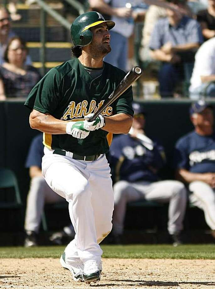 Oakland Athletics' Eric Chavez hits a triple against the Milwaukee Brewers in the second inning during a spring training baseball game on Friday, March 5, 2010, in Phoenix. Photo: Rick Scuteri, AP