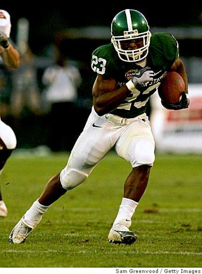 ORLANDO, FL - DECEMBER 28:  Javon Ringer #23 of the Michigan State Spartans runs for yardage during the Champs Bowl against the Boston College Eagles at the Citrus Bowl December 28, 2007 in Orlando, Florida.  (Photo by Sam Greenwood/Getty Images) Photo: Sam Greenwood, Getty Images
