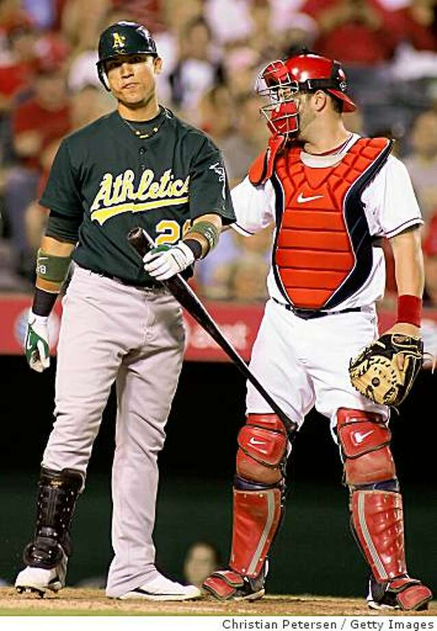 ANAHEIM, CA - AUGUST 26:  Carlos Gonzalez #28 of the Oakland Athletics reacts in front of catcher Mike Napoli #44 of the Los Angeles Angels of Anaheim after striking out during the game at Angel Stadium on August 26, 2008 in Anaheim, California. The Angels defeated the Athletics 5-1. (Photo by Christian Petersen/Getty Images) Photo: Getty Images