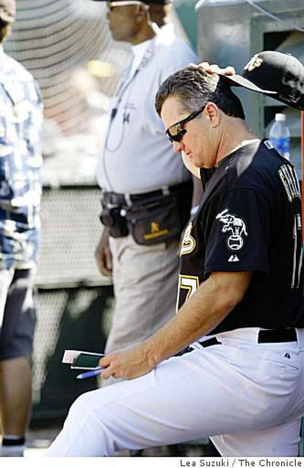 Manager Bob Geren watches the eighth inning from next to the dug out during the Oakland Athletics vs. Minnesota Twins game at McAfee Stadium on Sunday August 31, 2008 in Oakland, Calif. Final Score:  Minnesota 12 - Athletics 4. Photo: Lea Suzuki, The Chronicle