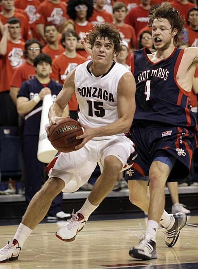Matt Bouldin drives against St. Mary's Matthew Dellavedova during the first half of their NCAA college basketball game at the McCarthey Athletic Center in Spokane, Wash. Thursday, Feb. 11, 2010. Photo: Rajah Bose, AP