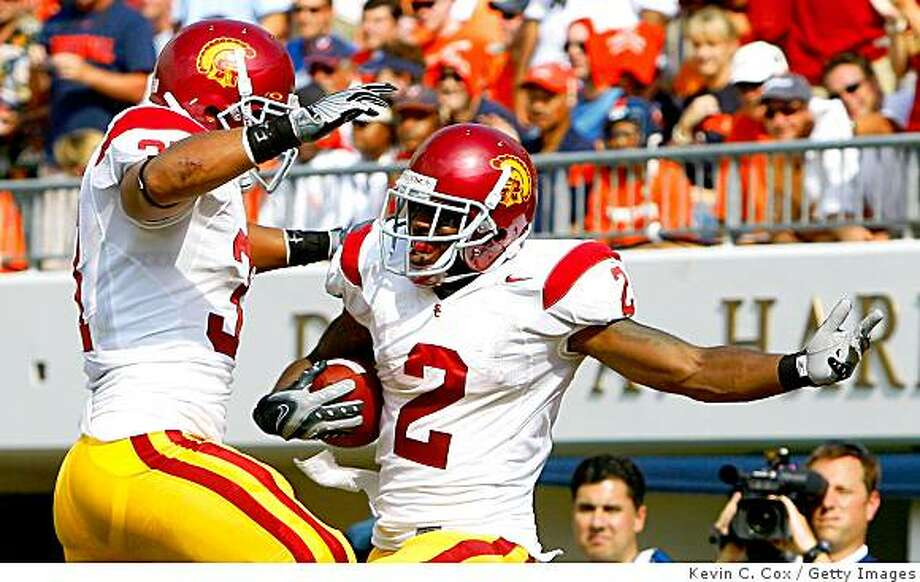 CHARLOTTESVILLE, VA - AUGUST 30:  Tailback C.J. Gable #2 of the Southern California Trojans celebrates his touchdown with fullback Stanley Havili #31 against the Virginia Cavaliers during the game at Scott Stadium on August 30, 2008 in Charlottesville, Virginia.  (Photo by Kevin C. Cox/Getty Images) Photo: Getty Images