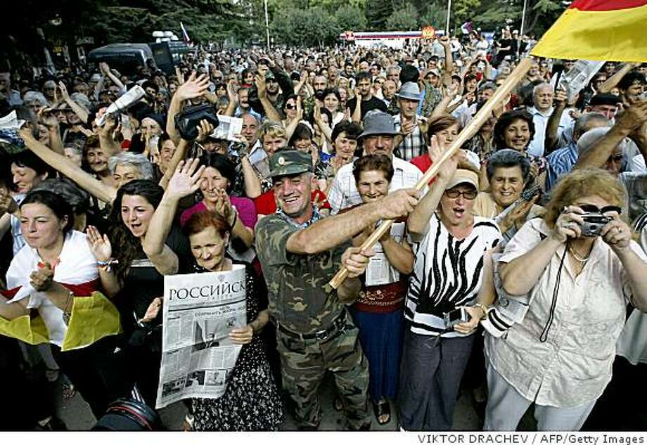 South Ossetians celebrate the recognition of their independence by Russia on August 27, 2008 in Tskhinvali. European leaders raised fears on August 27 that Russia could set its sights on other neighbouring countries after recognising two Georgian rebel regions as independent states.   AFP PHOTO/ VIKTOR DRACHEV (Photo credit should read VIKTOR DRACHEV/AFP/Getty Images) Photo: VIKTOR DRACHEV, AFP/Getty Images