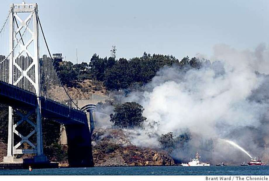A smoky fire on Yerba Buena Island brought out a San Francisco fire boat which helped battle the blaze from the bay. Photo: Brant Ward, The Chronicle