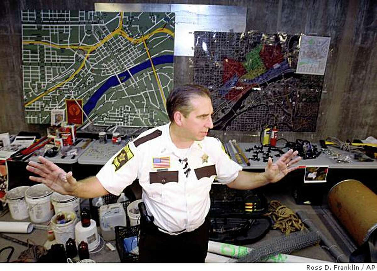 Bob Fletcher, Ramsey County Sheriff, shows some of the confiscated materials during a news conference in at the Republican National Convention in St. Paul, Minn., Saturday, Aug. 30, 2008. Police raided several homes in Minneapolis and St. Paul on Friday and Saturday and four people were arrested and booked on probable cause of conspiracy to commit a riot. (AP Photo/Ross D. Franklin)
