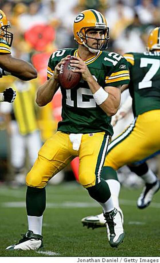 GREEN BAY, WI - AUGUST 28: Aaron Rodgers #12 of the Green Bay Packers drops back to pass on his only play of the game, a touchdown pass to Greg Jennings, in the 1st quarter against the Tenessee Titans on August 28, 2008 at Lambeau Field in Green Bay, Wisconsin. (Photo by Jonathan Daniel/Getty Images) Photo: Jonathan Daniel, Getty Images