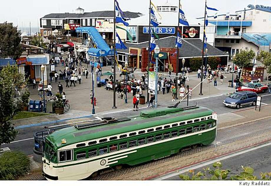 The F line vintage streetcars add to the atmosphere on The Embarcadero at Pier 39, in San Francisco, Calif. on Wednesday, August 20, 2008. Photo: Katy Raddatz