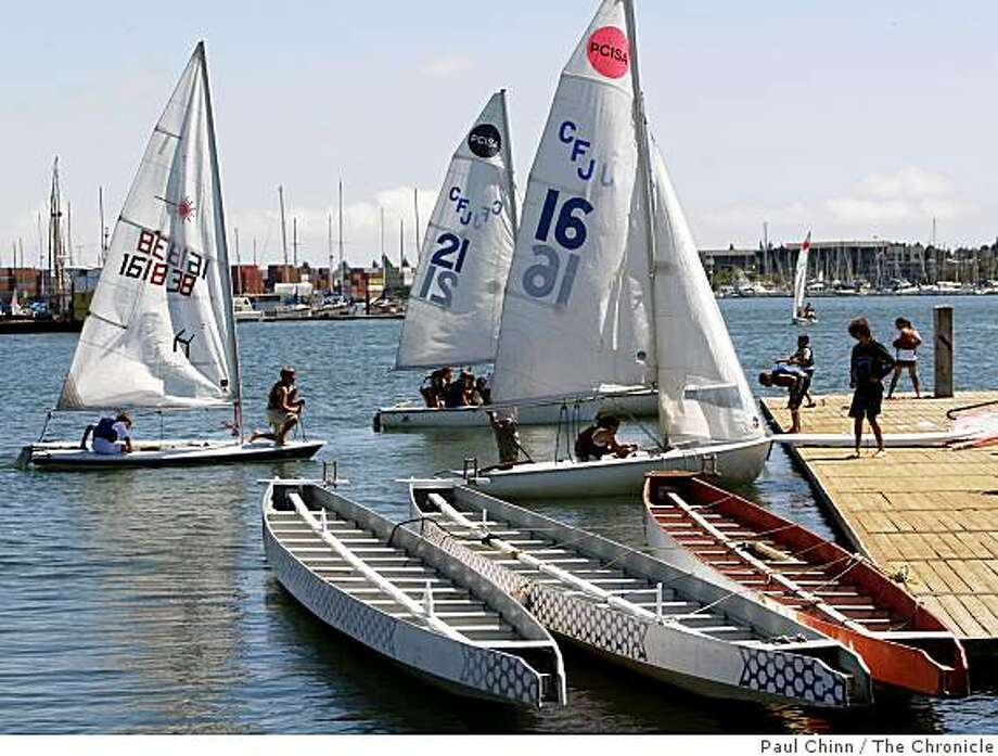 A flotilla of sailboats arrives at the Estuary Park dock in Oakland, Calif., on Thursday, Aug. 21, 2008. Photo: Paul Chinn, The Chronicle
