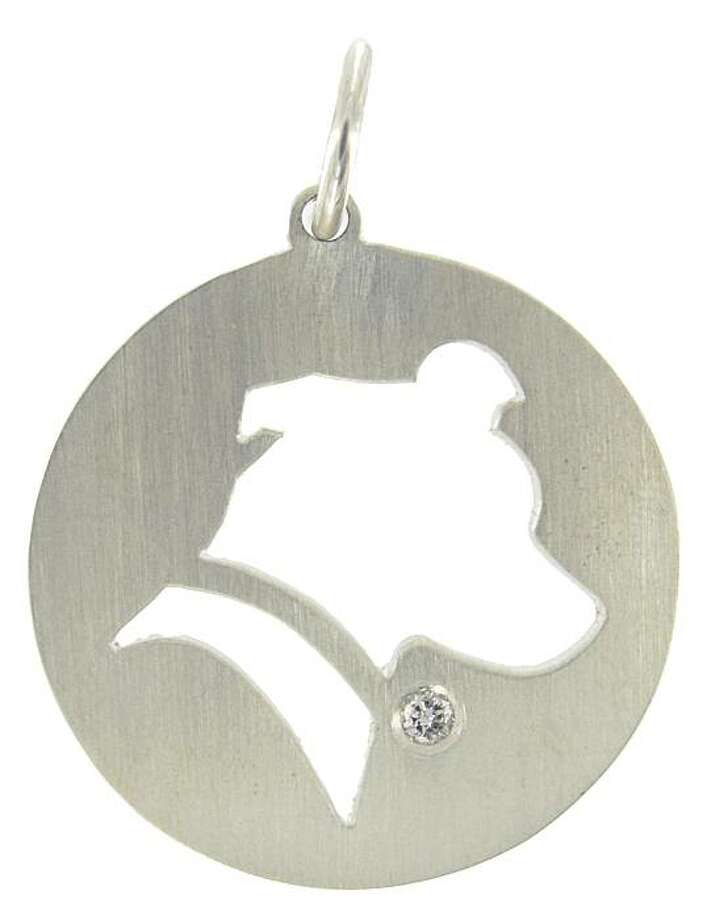 A sihouette pet charm, which can be personalized with your pet's profile, by designer Vincent Agor. Photo: Vincent Agor