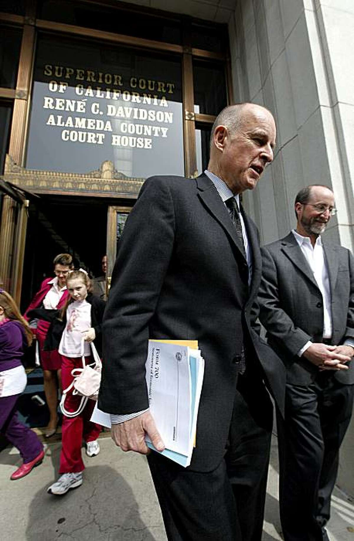 California Attorney General Jerry Brown departs the County Administration Building in Oakland, Calif. after filing his papers at Registrars office to make official his run for Governor of the State of California on Friday Mar. 5, 2010.
