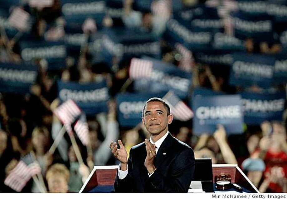 Democratic U.S. Presidential nominee Sen. Barack Obama (D-IL) reacts to the crowd on day four of the Democratic National Convention. Photo: Getty Images