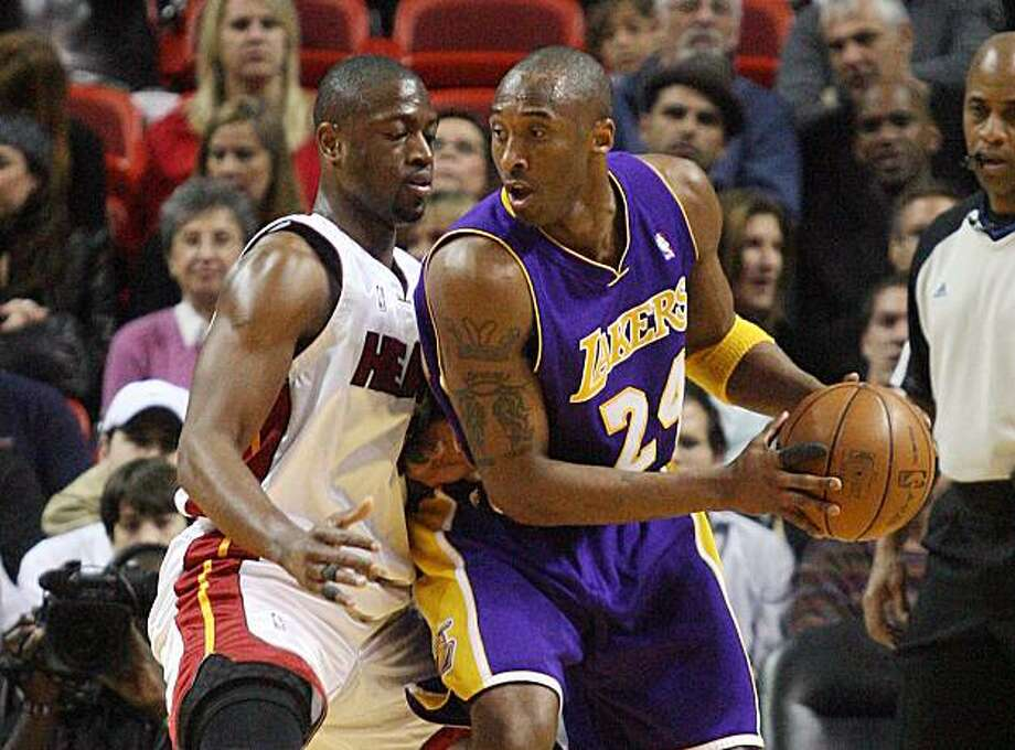 Miami Heat's Dwyane Wade guards Los Angeles Lakers' Kobe Bryant during the second quarter at the American Airlines Arena in Miami, Florida, Thursday, March 4, 2010. (Hector Gabino/El Nuevo Herald/MCT) Photo: Hector Gabino, MCT
