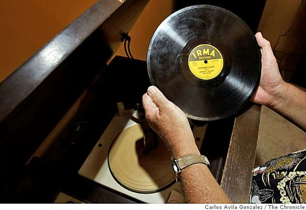Opal Nations holds one of his classic 76 RPM records at his Oakland, Calif., home on Thursday, August 21, 2008, where he keeps his extensive collection of 76 RPM records.