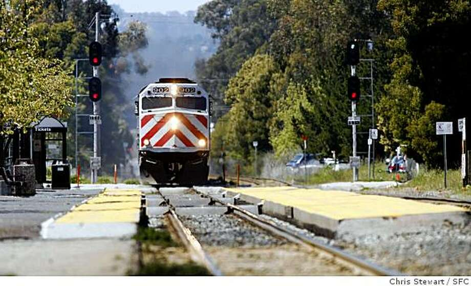 In this file photo,  a CalTrain passenger train passes through Burlingame. Photo: Chris Stewart, SFC